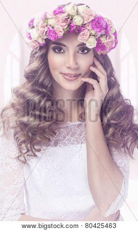 Pretty woman portrait with flowers tiara