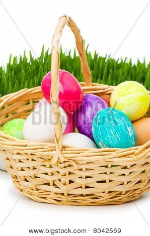 Eggs In The Basket And Grass Isolated On White