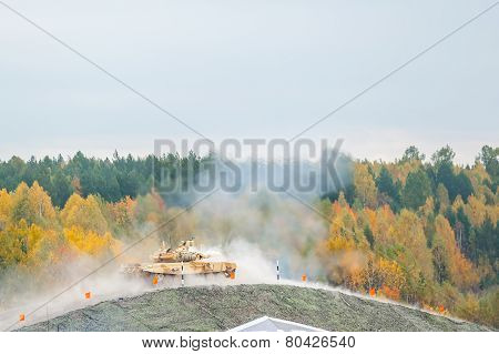 Tank T-90S shoots on hill