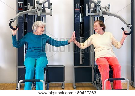 Old Ladies Exercising While Touching Their Palms