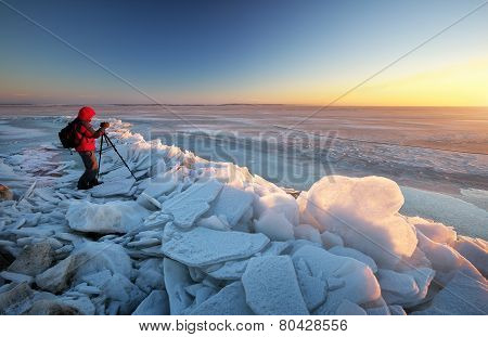 Photographer Take Pictures On The River Bank In Winter