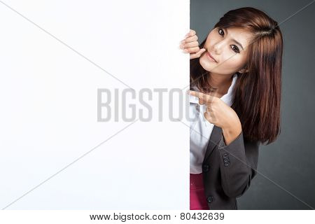Asian Businesswoman Stand Behind A Blank Banner And Point