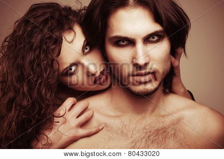 glamorous portrait of a pair of vampire lovers