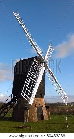 English post windmill with brick skirt, view #1