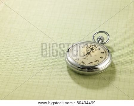 stop watch on the checker exercise book