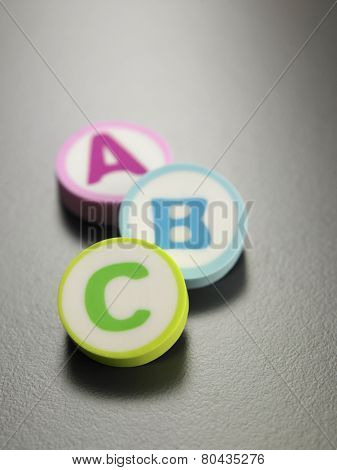 a b c printed on the round shape eraser