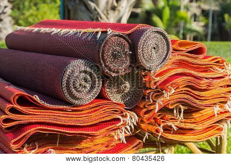 Pile Of Red Asian Rattan Mat