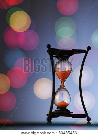 hour glass with beautiful light as background