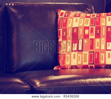 Close up of sofa in the living room toned with a retro vintage instagram filter effect