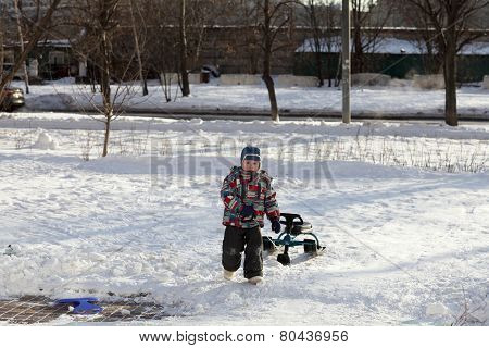 Child With A Snow Racer