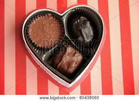 Small box of chocolates on striped plate