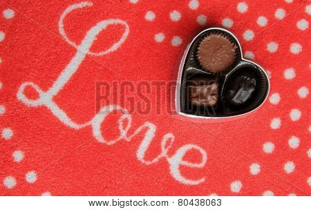 Sign that reads 'love' and chocolates