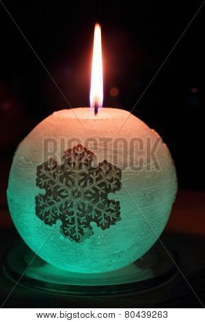 Glowing candle with a diode and snowflake