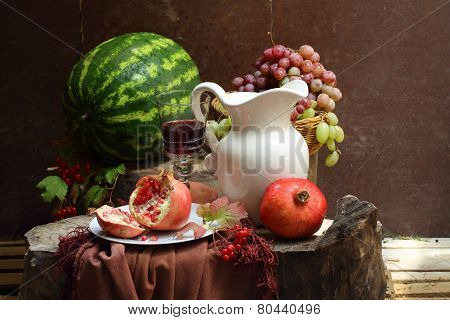 Still-life With Red Wine, A Pomegranate, Grapes And A Water-melon