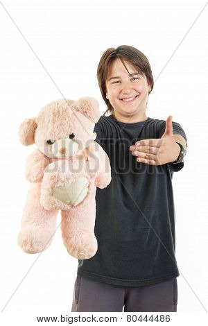 Boy Smiling And Holding Teddy Bear Toy As Gift