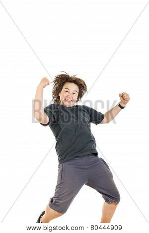 Boy Smiling With Face Expression And Jumping In Black Dark T-shirt