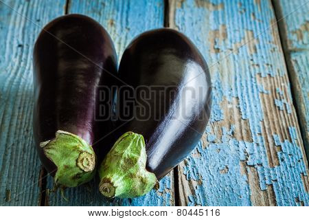 Two Raw Organic Eggplant On Old Wooden Background