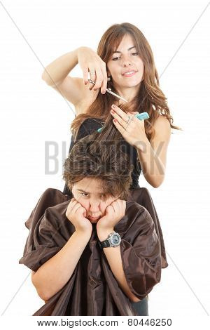 Disappointed Boy With Long Hair At Hairdresser