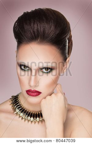 Glamour portrait of beautiful woman model with creativ makeup and original hairstyle. Fashion shiny