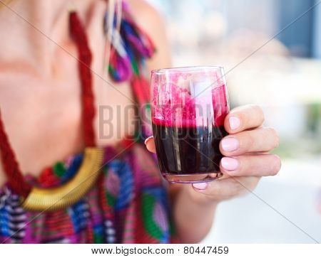 Woman Holding Glass Of A Beetroot Juice