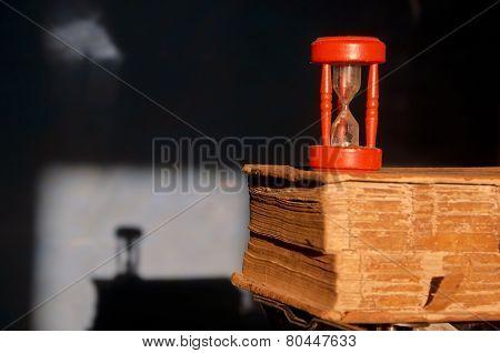 Antique Book And Red Broken Sandglass Hourglass