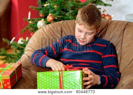 Boy Is Opening His Christmas Presents