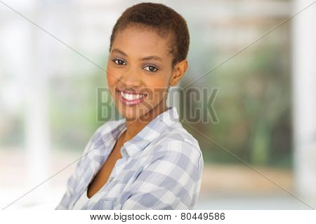 close up portrait of young african american woman at home