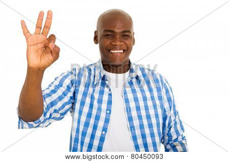 cheerful african american man giving ok hand sign isolated on white