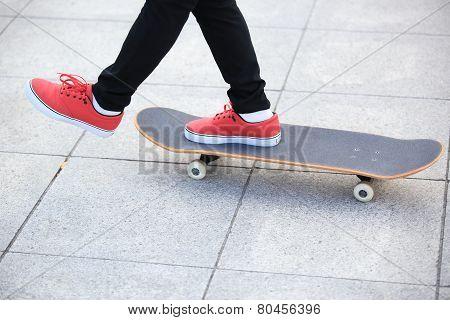 woman legs skateboarding