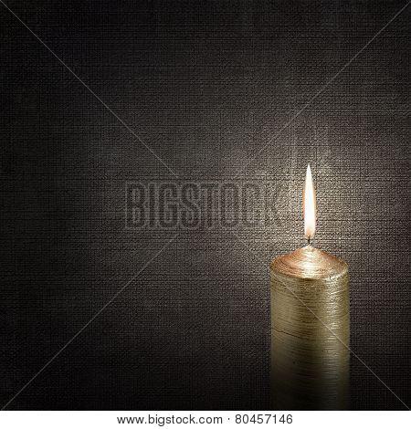 Burning Candle Over Vintage Embossed Dark Backgrounds