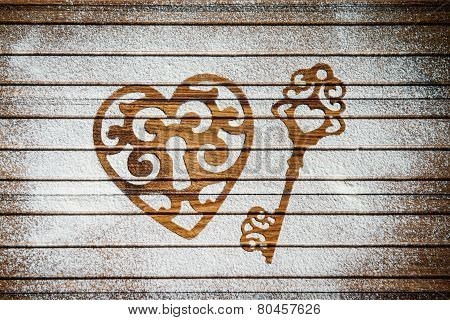 Heart and a key of the flour as a symbol of love on wooden background.  Valentines day background.