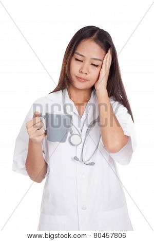 Asian Young Female Doctor Got Sick With A Cup Of Coffee