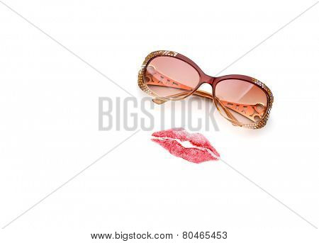 Glasses and lips forming woman face
