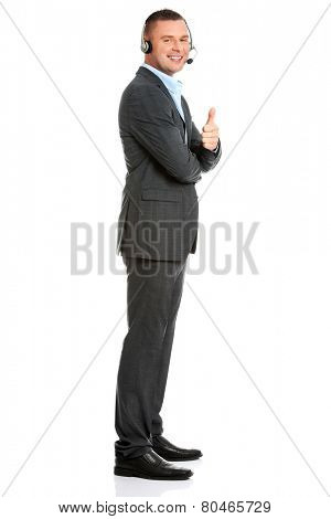 Customer service representative wearing a headset and gesturing thumbs up