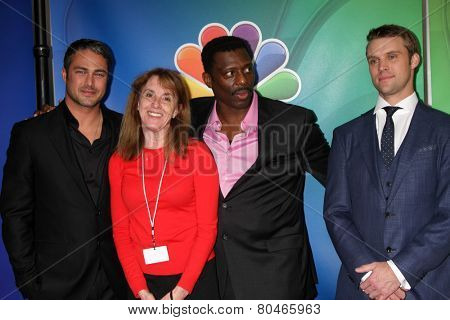 LOS ANGELES - DEC 16:  Taylor Kinney, Pam Golum, Eamonn Walker, Jesse Spencer at the NBCUniversal TCA Press Tour at the Huntington Langham Hotel on January 16, 2015 in Pasadena, CA