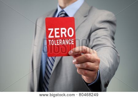 Showing a zero tolerance red card concept for bad business practice, exclusion or criminal activity