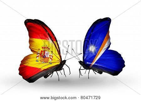 Two Butterflies With Flags On Wings As Symbol Of Relations Spain And Marshall Islands