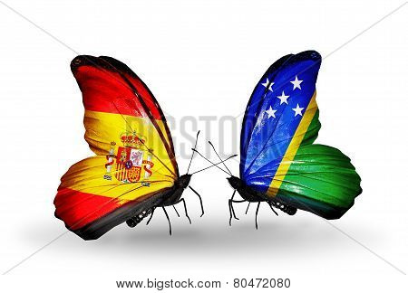 Two Butterflies With Flags On Wings As Symbol Of Relations Spain And Solomon Islands