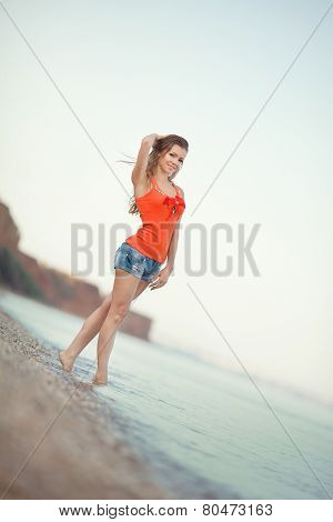 Beautiful smiling woman on the background of the sea.