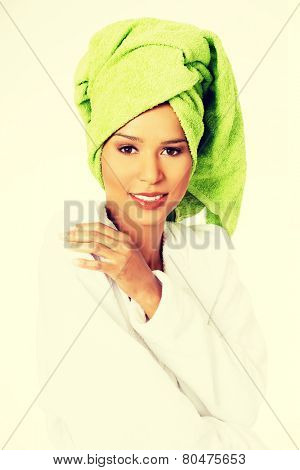 Attractive spa woman wrapped in towel with turban on head.