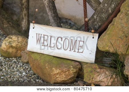 Welcome Sign At The Side Of A Foot Path