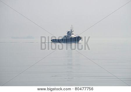 Sea Ship-tug Floats In The Mist