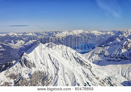 Niesen Swiss Alpine Peak And Brienz Lake Winter Helicopter View