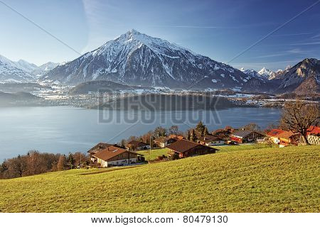 Panoramic Lakeview In Swiss Mountains Near The Thun Lake In Winter