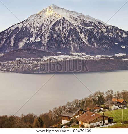 Panoramic View Over Swiss Apls Mountains Near The Thun Lake In Winter