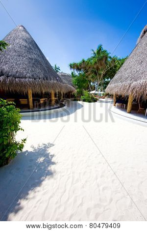 Bungalow on the coral beach. Concept of romantic holidays