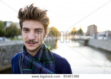 Young attractive man in real authentic life on city street