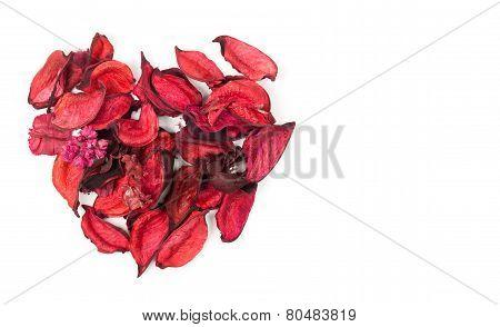 Potpourri in heart shape on white