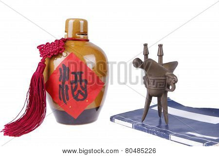 The traditional Chinese liquor and bronze cup