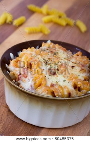 rotini spiral pasta gratin on table